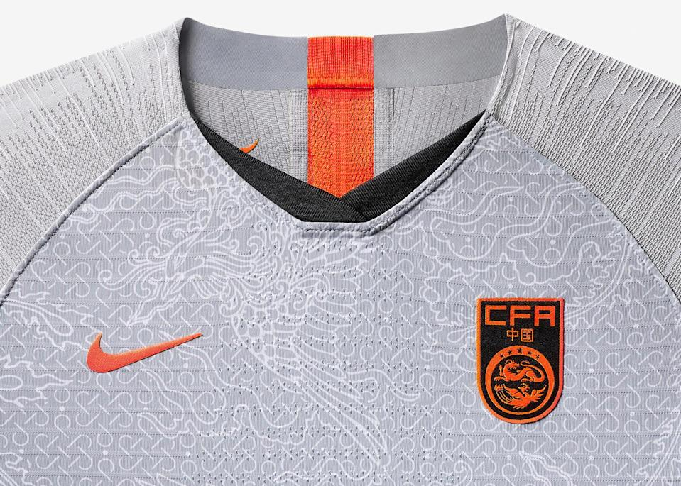 <p>China's new away shirt carries a brilliant all-over Phoenix print conveying femininity and virtue. Crimson pops on the sleeve enliven the gray tonal body, and a second Phoenix print sits within the kit as a symbol of inner pride. </p>