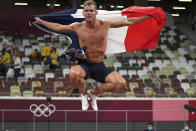 Kevin Mayer, of France, celebrates after his second place finish in the decathlon at the 2020 Summer Olympics, Thursday, Aug. 5, 2021, in Tokyo. (AP Photo/Matthias Schrader)