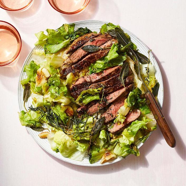 <p>This easy dinner takes just 20 minutes to prepare, meaning that seared steak can be a weeknight meal. Cooking herbs in the pan with the steak releases their aroma, infusing it into the meat while creating a crispy garnish. After the steaks and herbs are pan-seared, the escarole is cooked in the same skillet, so this healthy dinner requires minimal cleanup too.</p>