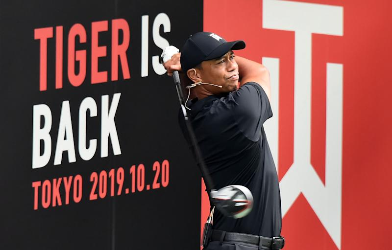 Woods shows off his swing during a workshop at the Meiji University in Tokyo on Sunday.