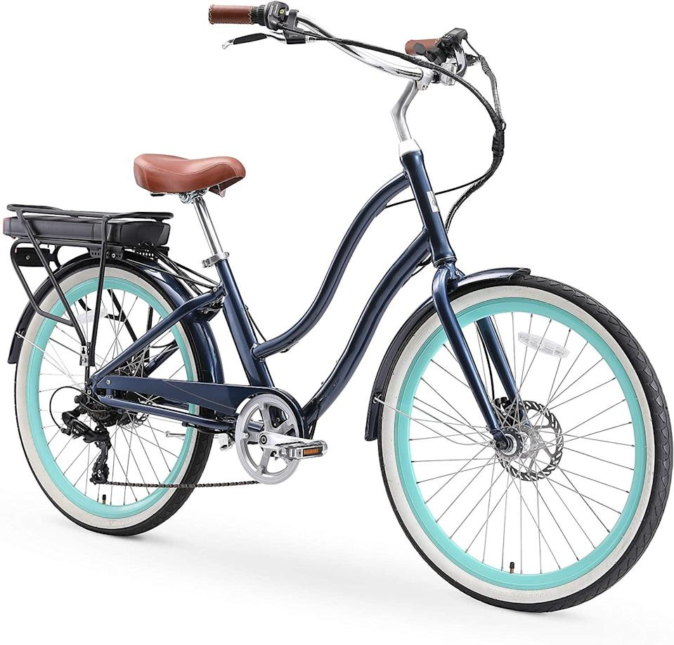 "<h3>sixthreezero EVRYjourney Women's Step-Through Hybrid Beach Cruise<br></h3> <br><strong>Best For: Comfortable Commutes </strong><br>If you want an easy ride to work look no further: This beach cruiser-style electronic bike lets you sit up straight <em>and</em> has a motor for assists on hills. You won't have to worry about arriving at work sweaty. While this won't take you off-roading, the bike will also handle well on weekend errands and adventures. <br><br><strong>Good To Know</strong>: A rear rack gives you a spot to store lunch, work supplies, and more. <br><br><strong>What Happy Bikers Say: </strong>""As a college student who relies on biking as a means of transportation, I was originally skeptical of riding a cruiser-style hybrid bike for an extensive milage on busy streets, but I can happily say that this bike is the best commuter bike I've ridden. The seat is extremely comfortable, the comfortable handlebars allow for smooth turns and the brakes are naturally positioned for those quick (and sometimes scary) stops, and the 7-speed gear shifts handle steep hills like a charm. The miles seem to fly by with this bike.""<br><br><br><strong>sixthreezero</strong> EVRYjourney Women's Step-Through Hybrid Cruiser, $, available at <a href=""https://www.amazon.com/sixthreezero-EVRYjourney-Step-Through-Touring-Bicycle/dp/B07Q96WNHG/"" rel=""nofollow noopener"" target=""_blank"" data-ylk=""slk:Amazon"" class=""link rapid-noclick-resp"">Amazon</a><br><br><br><br><br><br><br>"