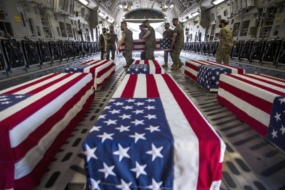 FILE - In this Aug. 12, 2020, file photo provided, by the U.S. Marine Corps, U.S. Marines and sailors carry a casket of the remains of one service personnel who died when their amphibious vehicle sank off the California coast, inside a U.S. Air Force C-17 Globemaster III at Marine Corps Air Station Miramar, in Calif. A new military investigation found coronavirus pandemic curtailed trainings in 2020 and contributed to nine service members drowning off the San Diego's coast. The findings were released Wednesday, Oct. 6, 2021 were from the latest investigation into the sinking of the amphibious assault vehicle on July 30, 2020. (Lance Cpl. Brendan Mullin/U.S. Marine Corps via AP, File)