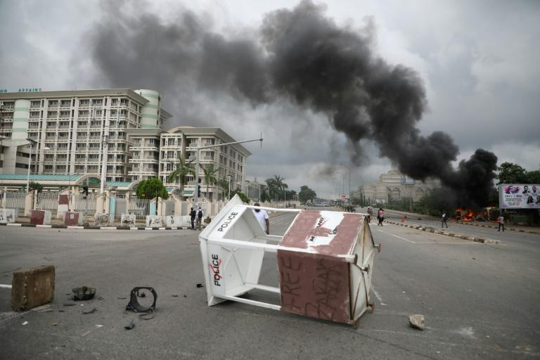 At least eight people were killed in clashes between police and protesters in Nigeria's capital Abuja in July (AFP Photo/Kola SULAIMON)