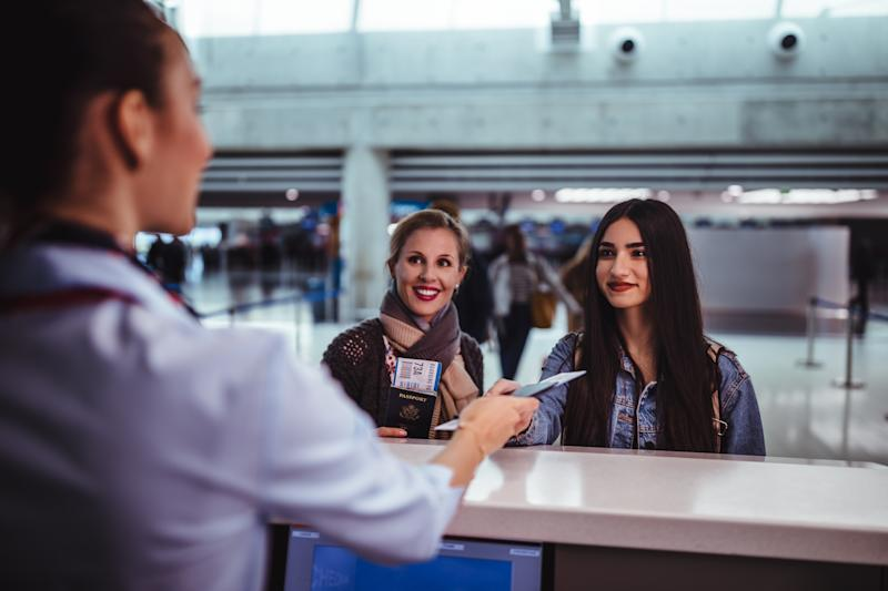 Airline hands woman ticket