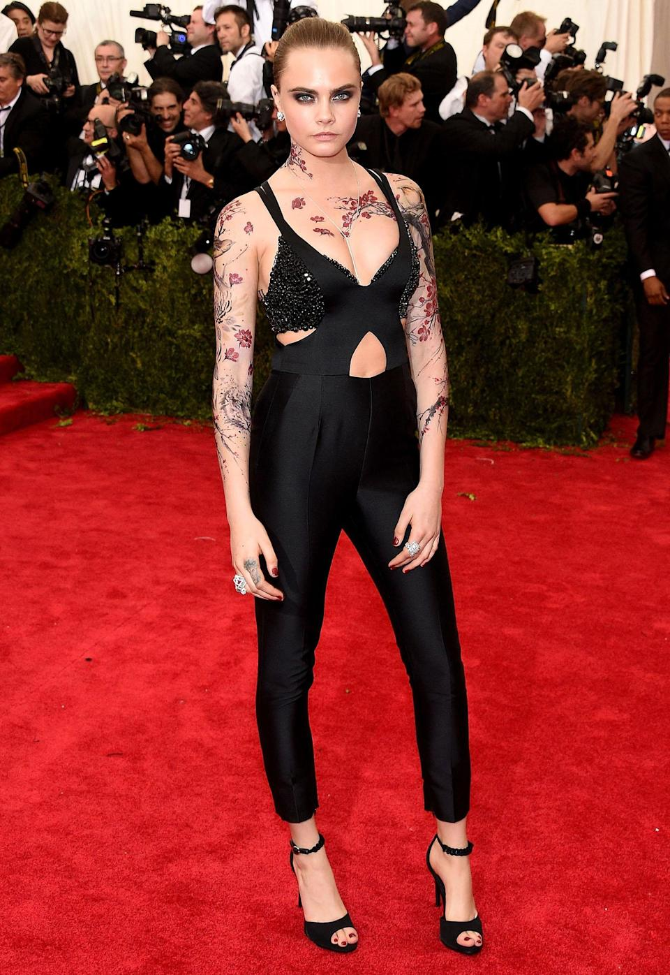 <p>Delevingne incorporated temporary body art with her 2015 Met Gala look. (Photo: Larry Busacca/Getty Images) </p>