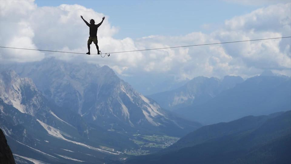 Investors, like this tightrope-walker, are confident that markets and the economy won't stumble in the years to come.