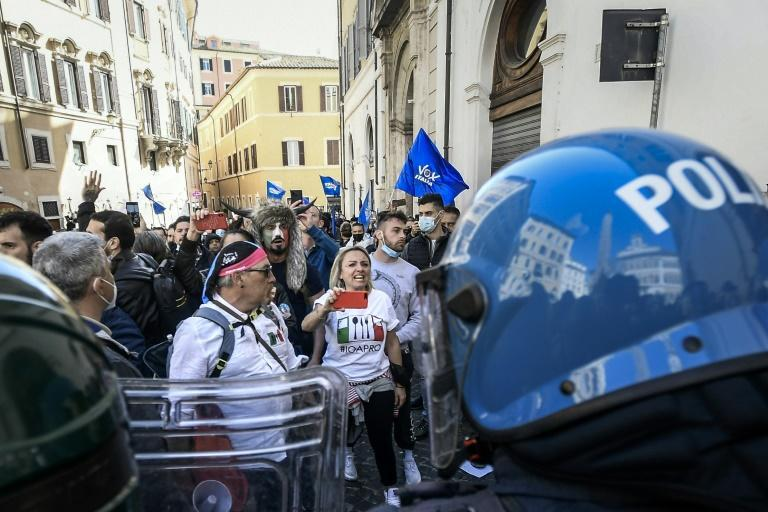 Social media has given the conspiracy movement a global aesthetic, as with the Italian demonstrator (Rear C) seen costumed as one of the January 6 rioters at the US Capitol