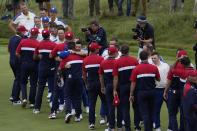 Team USA shakes hands with Team Europe after the Ryder Cup matches at the Whistling Straits Golf Course Sunday, Sept. 26, 2021, in Sheboygan, Wis. (AP Photo/Jeff Roberson)