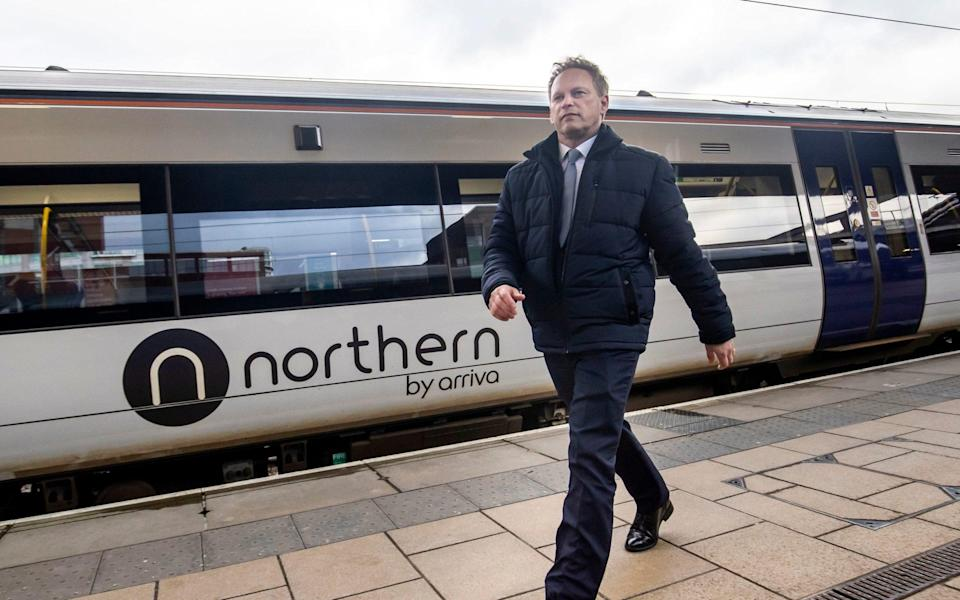 Transport Secretary Grant Shapps passing a Northern train while visiting Leeds railway station - PA