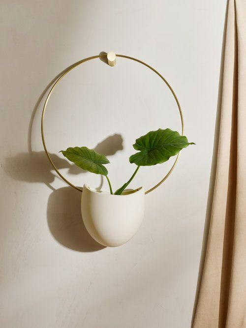 "Make a statement with this oversized wall-mounted planter that hangs from a sleek brass ring. It's got an understated elegance that will look good in any room. $180, Food52. <a href=""https://food52.com/shop/products/5474-brass-spora-with-brass-hanger"" rel=""nofollow noopener"" target=""_blank"" data-ylk=""slk:Get it now!"" class=""link rapid-noclick-resp"">Get it now!</a>"