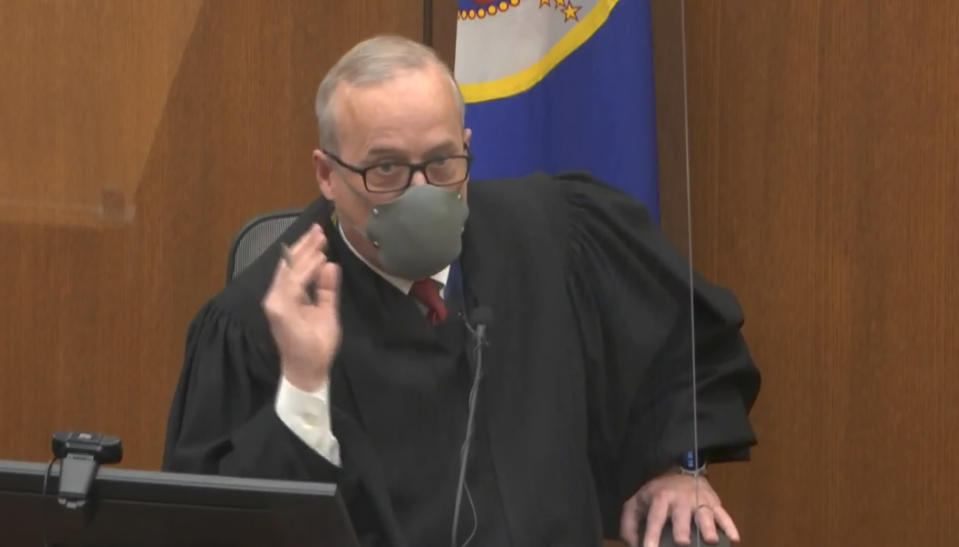 In this image from video, Hennepin County Judge Peter Cahill presides over court Firday, April 9, 2021, in the trial of former Minneapolis police Officer Derek Chauvin at the Hennepin County Courthouse in Minneapolis, Minn. Chauvin is charged in the May 25, 2020 death of George Floyd. (Court TV via AP, Pool)