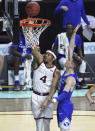 Gonzaga guard Aaron Cook (4) shoots against BYU guard Spencer Johnson during the first half of an NCAA college basketball game for the West Coast Conference men's tournament championship Tuesday, March 9, 2021, in Las Vegas. (AP Photo/David Becker)