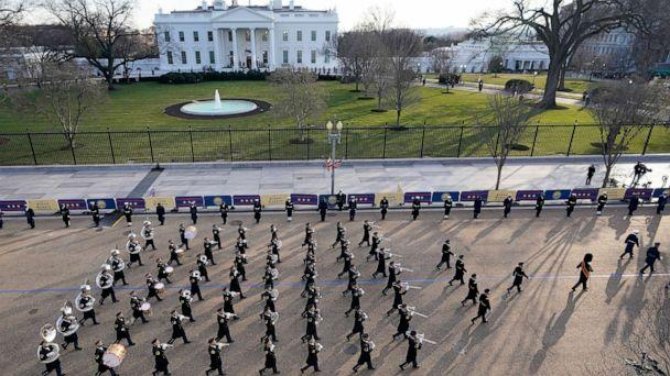 PHOTO: A U.S. Army band marches near the White House during the Presidential Escort, part of Inauguration Day ceremonies for President Joe Biden, Jan. 20, 2021. (David J. Phillip/AP)