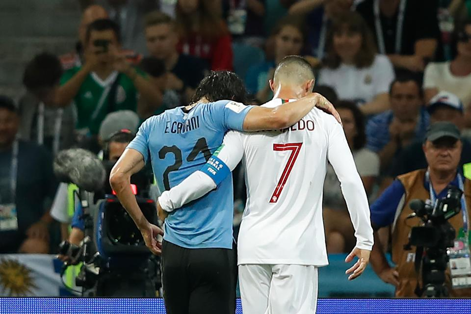 In the Round of 16 World Cup match between Portugal and Uruguay, Cristiano Ronaldo helped Uruguay's Edinson Cavani off of the field. (Getty Images)