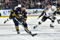 Buffalo Sabres center Marcus Johansson (90) skates with the puck during the second period of an NHL hockey game against the Los Angeles Kings in Buffalo, N.Y., Saturday, Dec. 21, 2019. (AP Photo/Adrian Kraus)