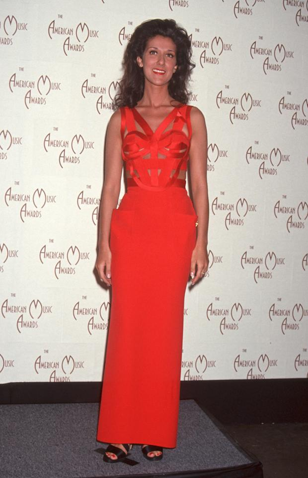 The next year, the singer wore a form fitting red gown with cutouts by Versace to the 20th Annual American Music Awards. 1993. Photo courtesy of Getty Images.