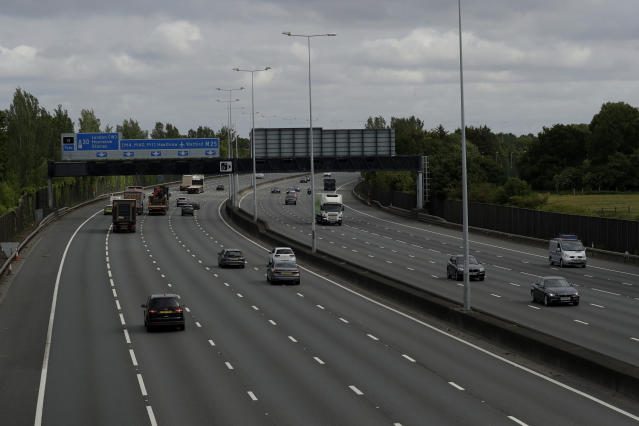 Traffic passes along the M25 London orbital motorway at just before 09:15am local time, near the town of Egham, on the western outskirts of London, Wednesday, May 13, 2020. Some of the coronavirus lockdown measures are being relaxed in England on Wednesday, with those workers who are unable to work from home, such as those in construction and manufacturing, encouraged to return to work. (AP Photo/Matt Dunham)