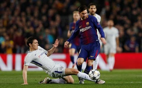 Lionel Messi dribbles round Andreas Christensen - Credit: Reuters