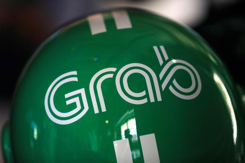 A Grab motorbike helmet is displayed during Grab's fifth anniversary news conference in Singapore