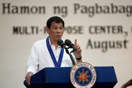 Philippine President Rodrigo Duterte gestures while delivering a speech during the 115th Police Service Anniversary at the Philippine National Police (PNP) headquarters in Quezon city, metro Manila