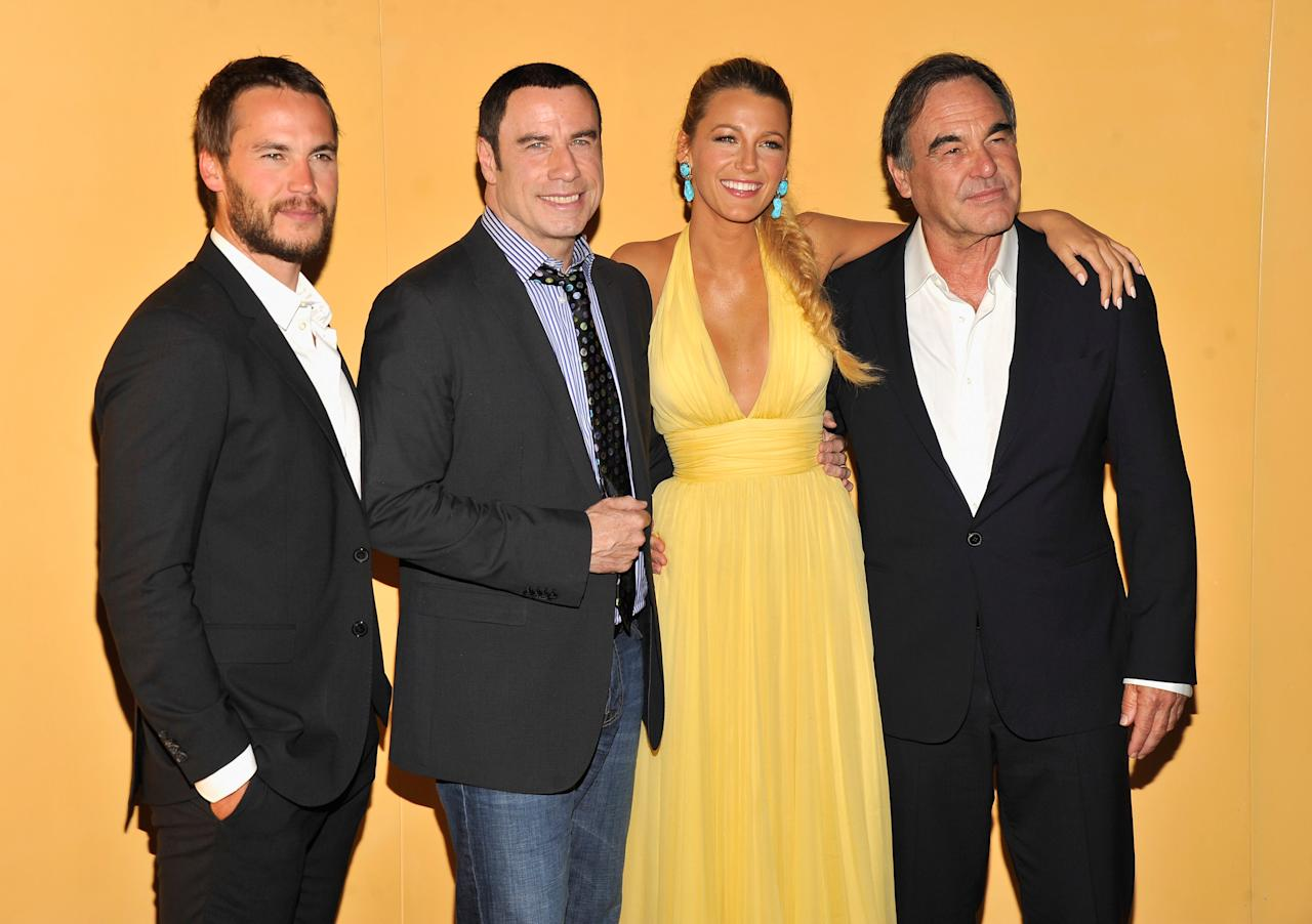 """NEW YORK, NY - JUNE 27:  (L-R) Taylor Kitsch, John Travolta, Blake Lively and Director Oliver Stone attend the """"Savages"""" New York premiere at SVA Theater on June 27, 2012 in New York City.  (Photo by Stephen Lovekin/Getty Images)"""