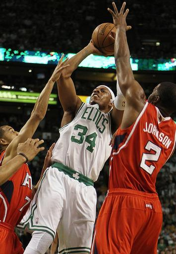 BOSTON, MA - MAY 06: Paul Pierce #34 of the Boston Celtics shoots a basket as Joe Johnson #2 and Jannero Pargo #7 of the Atlanta Hawks defends in the first quarter in Game Four of the Eastern Conference Quarterfinals during the 2012 NBA Playoffs on May 6, 2012 at TD Garden in Boston, Massachusetts. (Photo by Jim Rogash/Getty Images)
