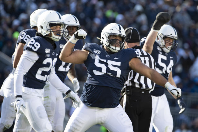 Penn State defensive tackle Antonio Shelton (55) celebrates after stopping Indiana tight end Peyton Hendershot (86) on a fake punt in the third quarter of an NCAA college football game in State College, Pa., on Saturday, Nov.16, 2019. Penn State defeated 34-27. (AP Photo/Barry Reeger)