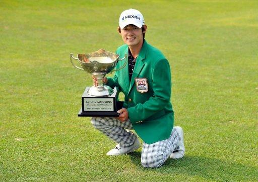 This handout photo provided by OneAsia shows Kim Bi-O of South Korea posing with the winner's trophy