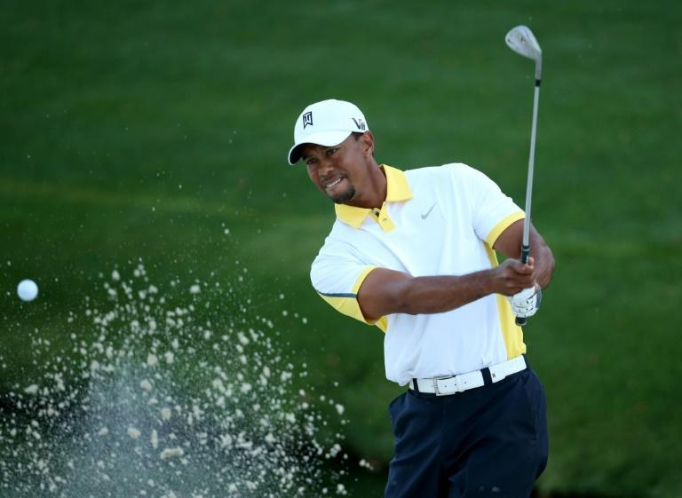 """Tiger Woods completed a """"Tiger Slam"""" by winning the 2001 Masters, capturing his fourth consecutive major title to own all four titles at once"""