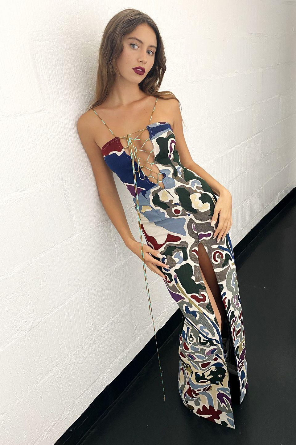 <p><strong>10 October </strong>Iris Law matched her plum lip to her Missoni patterned dress. </p>