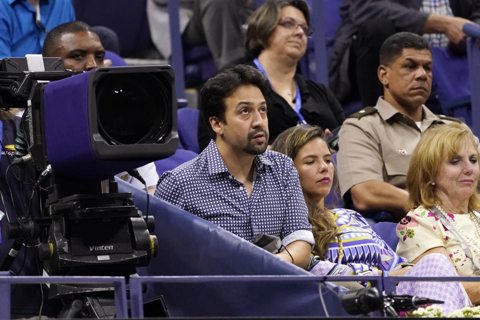 Actor Lin-Manuel Miranda, center, looks on at a match between Novak Djokovic, of Serbia, and Jenson Brooksby, of the United States, during the fourth round of the U.S. Open tennis championships at Arthur Ashe Stadium, Monday, Sept. 6, 2021, in New York. (AP Photo/John Minchillo)
