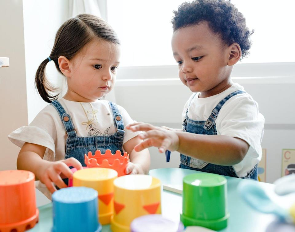 Two toddlers playing.