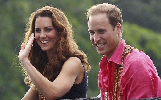 Prince William and his wife Catherine smile as they arrive at Marapa Island, on the Solomon Islands, on September 17. A French court is set to rule Tuesday on whether to ban the resale of photos of Catherine sunbathing topless, after the British royal family sought an injunction