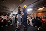 NDP Leader Jagmeet Singh, right, and his wife Gurkiran Kaur dance on stage after Singh addressed supporters during an election night party in Burnaby, B.C., on Monday, October 21, 2019. THE CANADIAN PRESS/Darryl Dyck