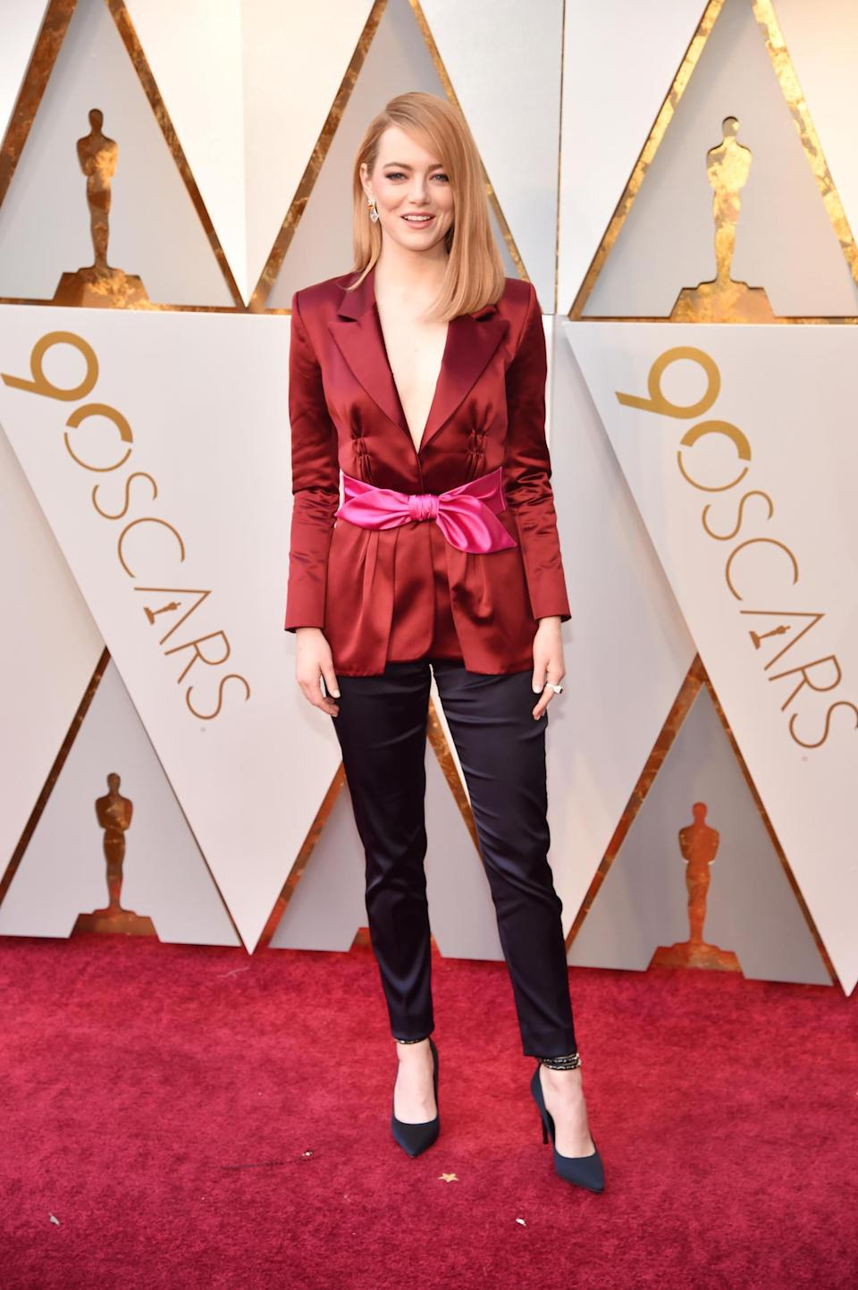 <p>Emma Stone proves that you don't need to wear a dress to be a standout on the red carpet. (Photo by Kevin Mazur/WireImage) </p>