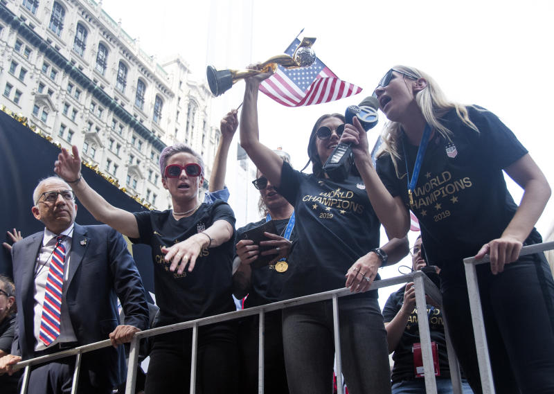 NEW YORK, NY - JULY 10: (L-R) United States Soccer Federation president Carlos Cordeiro, Megan Rapinoe, Ashlyn Harris, Alex Morgan and Allie Long celebrate while riding on a float during The U.S. Women's National Soccer Team Victory Parade and City Hall Ceremony down the Canyon of Heroes on July 10, 2019 in New York City. The team defeated the Netherlands 2-0 Sunday in France to win the 2019 WomenÕs World Cup. (Photo by Debra L Rothenberg/WireImage)