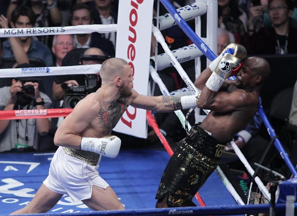 Mayweather overcame a spirited start from a brave but outclassed McGregor, dominating from the fourth round onwards (AFP Photo/John Gurzinski)