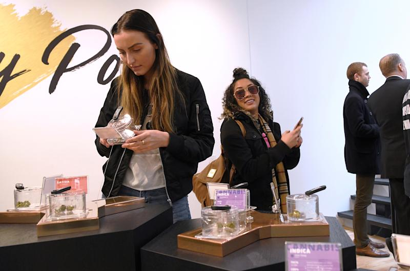 Customers and staff at the Hunny Pot Cannabis Co. retail cannabis store shop as marijuana retail sales commenced in the province of Ontario, in Toronto, Ontario, Canada April 1, 2019. REUTERS/Moe Doiron