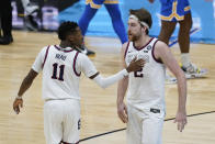 Gonzaga guard Joel Ayayi (11) and Drew Timme (2) react to a play against UCLA during overtime in a men's Final Four NCAA college basketball tournament semifinal game, Saturday, April 3, 2021, at Lucas Oil Stadium in Indianapolis. (AP Photo/Darron Cummings)