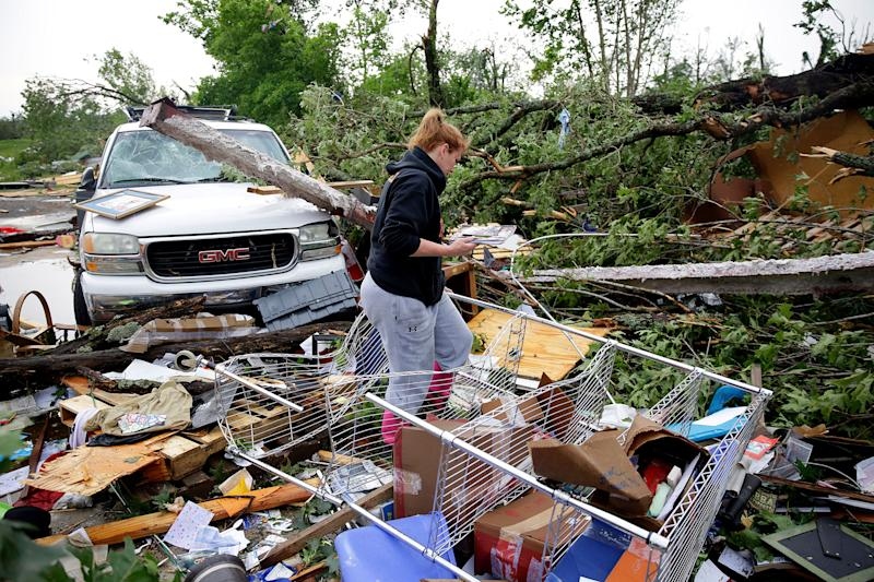 Michelle Underwood searches through the wreckage of a feed store on May 21, 2019, in Peggs, Okla. She had most of her belongs stored in the building. An apparent tornado hit the area Monday night.