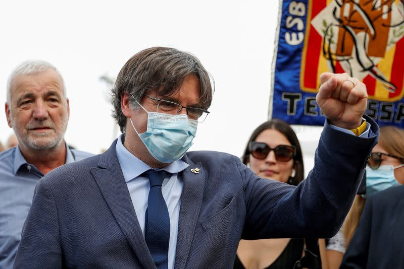 Former Catalan government head Carles Puigdemont walks in Alghero