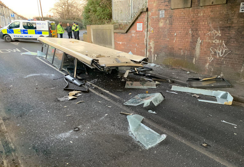 The bus roof lies on the road after being ripped off passing under a low bridge (York Press/SWNS)