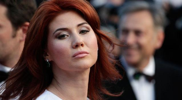 Russian Anna Chapman, who was deported from the U.S. in July 2010 on charges of espionage, poses for photographers as she arrives for the screening of Behind the Candelabra at the 66th international film festival.