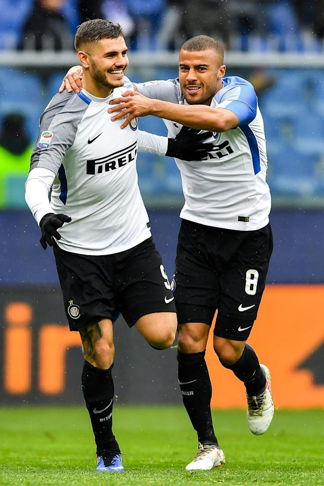 Inter's Mauro Icardi, left, celebrates with his teammate Alcantara Rafinha after scoring his fourth goal during the Italian Serie A soccer match between Sampdoria and Inter at the Luigi Ferraris Stadium in Genoa, Italy, Sunday, March 18, 2018. (Simone Avreda/ANSA via AP)
