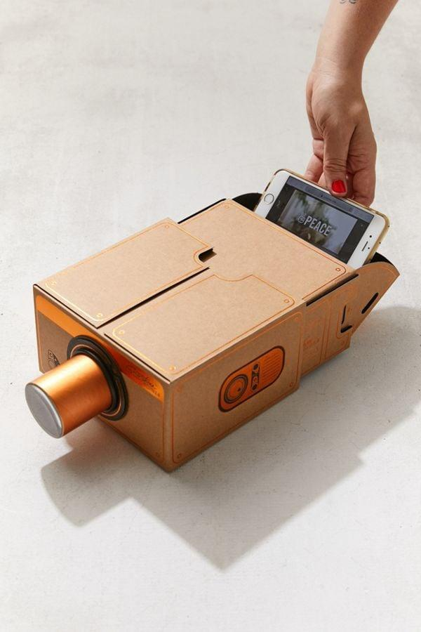 """<p>Take watching movies on your phone to a whole new level with this <a href=""""https://www.popsugar.com/buy/Smartphone-Projector-20-373313?p_name=Smartphone%20Projector%202.0&retailer=urbanoutfitters.com&pid=373313&price=30&evar1=savvy%3Aus&evar9=45684857&evar98=https%3A%2F%2Fwww.popsugar.com%2Ffood%2Fphoto-gallery%2F45684857%2Fimage%2F46825587%2FSmartphone-Projector-20&list1=shopping%2Cgifts%2Cgift%20guide%2Cgifts%20for%20men%2Cbest%20of%202019&prop13=api&pdata=1"""" rel=""""nofollow"""" data-shoppable-link=""""1"""" target=""""_blank"""" class=""""ga-track"""" data-ga-category=""""Related"""" data-ga-label=""""https://www.urbanoutfitters.com/shop/smartphone-projector-20?category=cell-phone-accessories&amp;color=020"""" data-ga-action=""""In-Line Links"""">Smartphone Projector 2.0</a> ($30).</p>"""