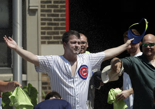 Chicago Cubs fans cool off before a baseball game between the San Diego Padres and the Chicago Cubs in Chicago, Saturday, July 20, 2019. Storms on Thursday postponed excessive heat warnings that went into effect at 10 a.m. Friday for Cook County and all of northern Illinois, southern Wisconsin and northwest Indiana. The worst of the heat was expected to pass by 7 p.m. Saturday. (AP Photo/Nam Y. Huh)