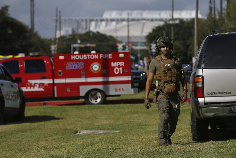 Law enforcement officials at the scene of an officer-involved shooting at an apartment complex on Tuesday, Oct. 20, 2020, in Houston. Two Houston officers were shot before a SWAT team was dispatched to the scene, where the suspected shooter was arrested, authorities said. (Godofredo A. Vásquez / Houston Chronicle via AP)