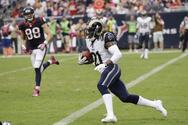 CORRECTS TO FOURTH QUARTER - St. Louis Rams cornerback Janoris Jenkins (21) runs back an interception from Houston Texans quarterback T.J. Yates during the fourth quarter of an NFL football game Sunday, Oct. 13, 2013, in Houston, Texas. (AP Photo/Eric Gay)