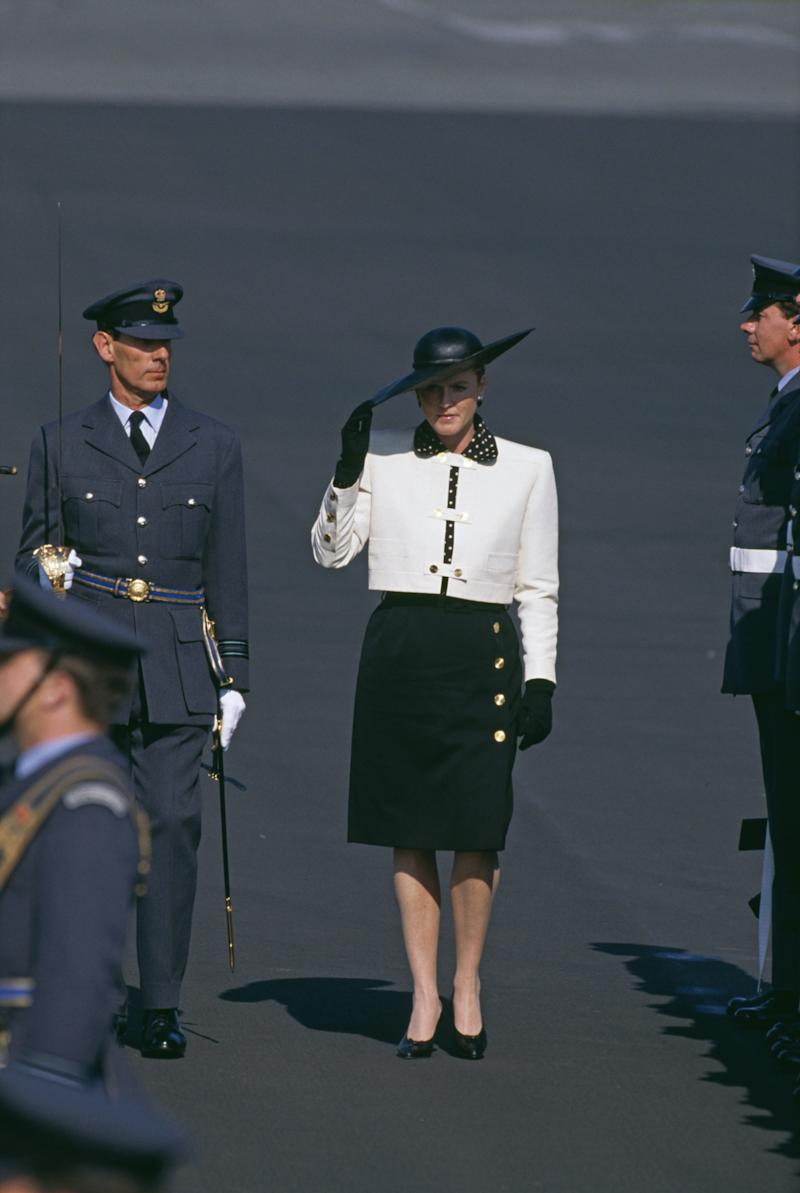 Sarah Ferguson, Duchess of York inspecting The Guard Of Honour at R.A.F. Gaton in Berlin, Germany, 1989. Photo by Georges De Keerle/Getty Images.