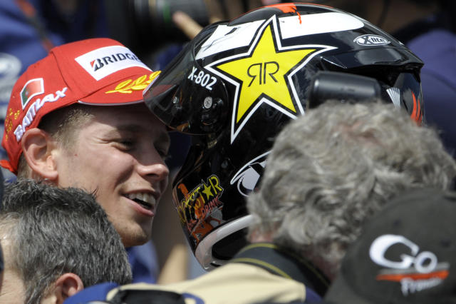 Repsol Honda team's Australian Casey Stoner (L) is congratulated by Yamaha Factory Racing team's Jorge Lorenzo (R) after wining the Moto GP race of the Portuguese Grand Prix in Estoril, outskirts of Lisbon, on May 6, 2012. Stoner won the race ahead of Spain's Lorenzo and Dani Pedrosa. AFP PHOTO / MIGUEL RIOPAMIGUEL RIOPA/AFP/GettyImages
